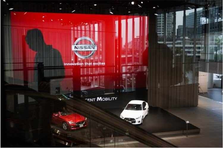 Scandal-hit Nissan sinks into losses as sales plummet