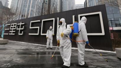 Beijing orders 14-day quarantine for all returnees