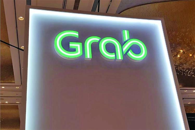 SoftBank-backed Grab raises $856m