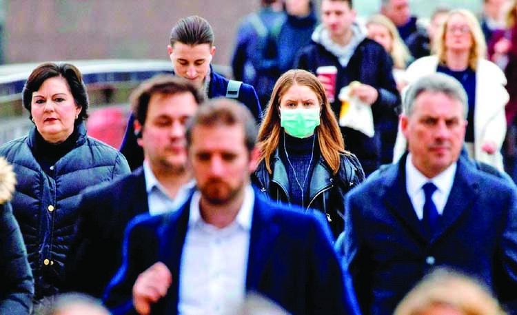 UK social distancing may last a year