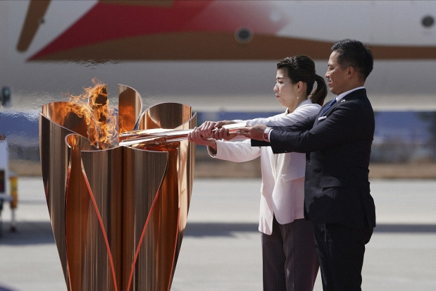 Flame in Japan; How long until news if Olympics will open?