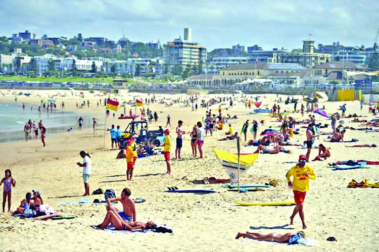 Australia puts beaches under lockdown