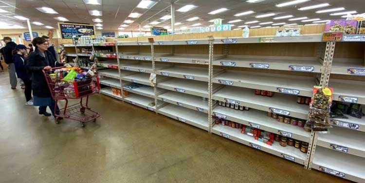 Americans rush to stock up on essentials, retailers scramble