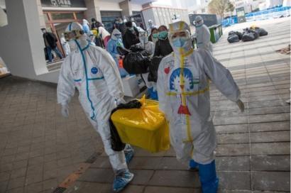 Wuhan to ease lockdown as world battles virus
