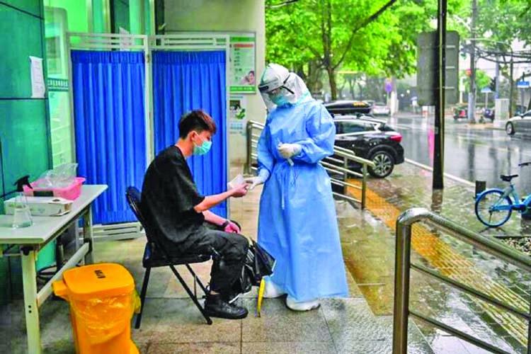 Fresh test for Wuhan as new cluster sparks coronavirus screening