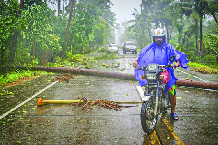 Typhoon forces risky evacuations in virus-hit Philippines