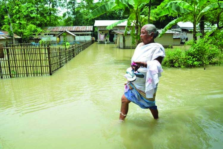 Floods in India's Assam force a million to flee