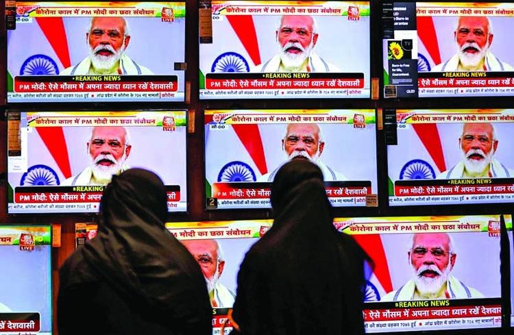 Modi extends free food grain program for poor
