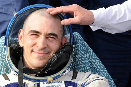 Russian cosmonaut votes on Putin's reforms from ISS