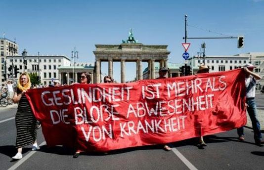 Berlin protest against virus curbs draws thousands