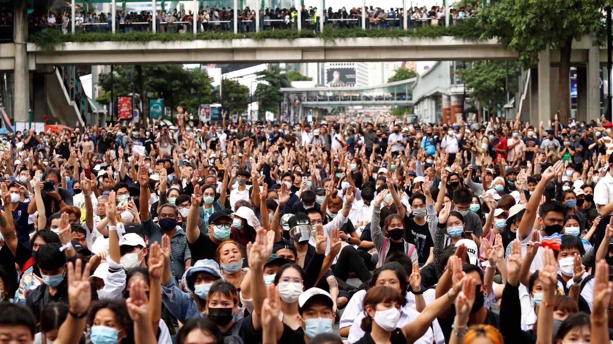 Thousands of protesters defy Thai crackdown, flood Bangkok