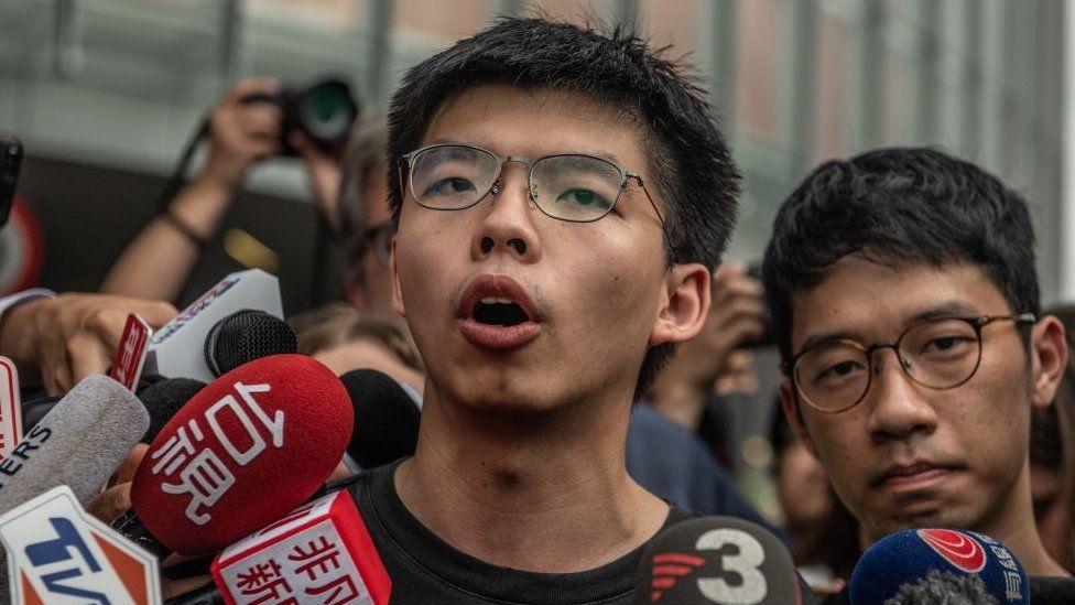 HK activist Joshua Wong jailed over Tiananmen vigil