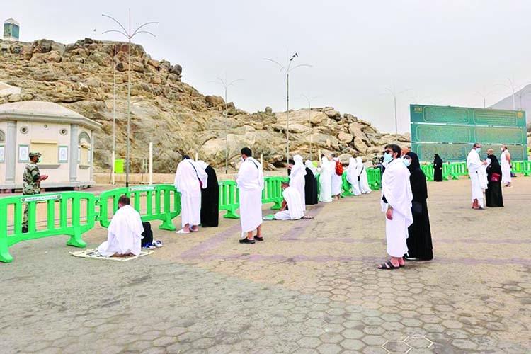 Masked hajj pilgrims on Mount Arafat pray for Covid-free world