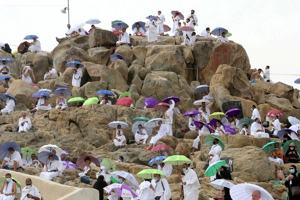 Pilgrims pray on Mount Arafat at high point of pandemic-era hajj