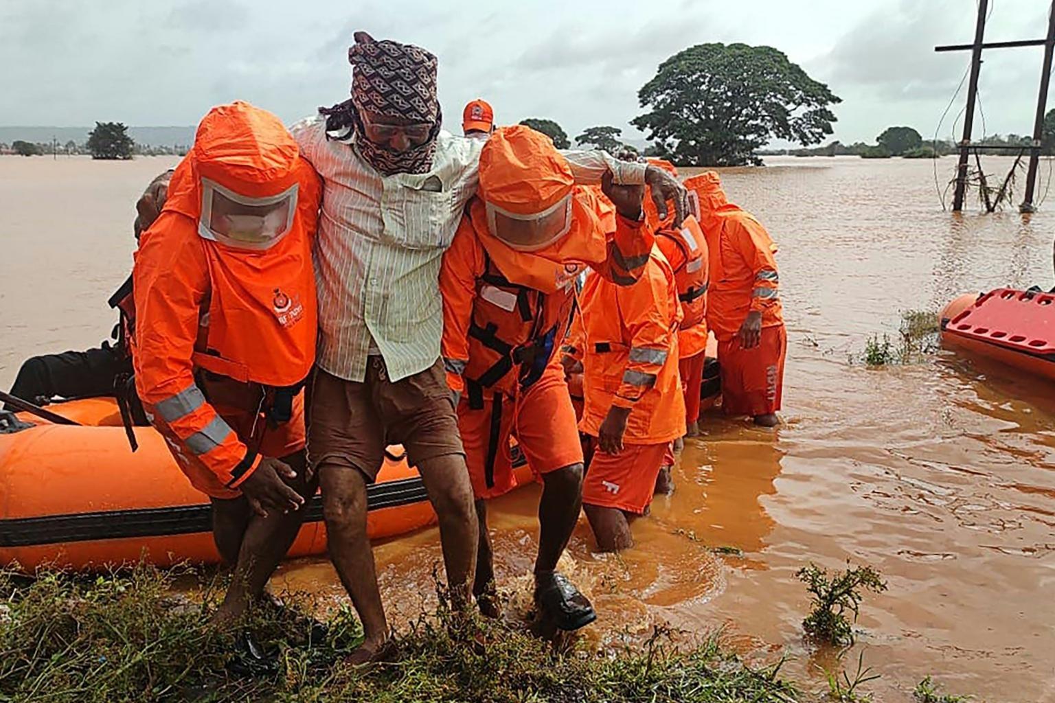 India begins landslide, flood clean-up as deadly monsoon rains ease