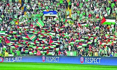 Celtic fans defy UEFA ban to fly sea of Palestine flags in match against Israeli