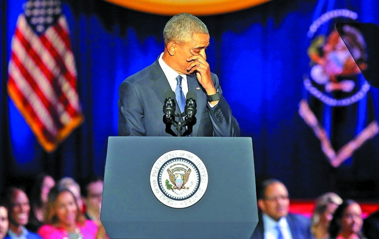 Obama tears up during tribute to Michelle and daughters