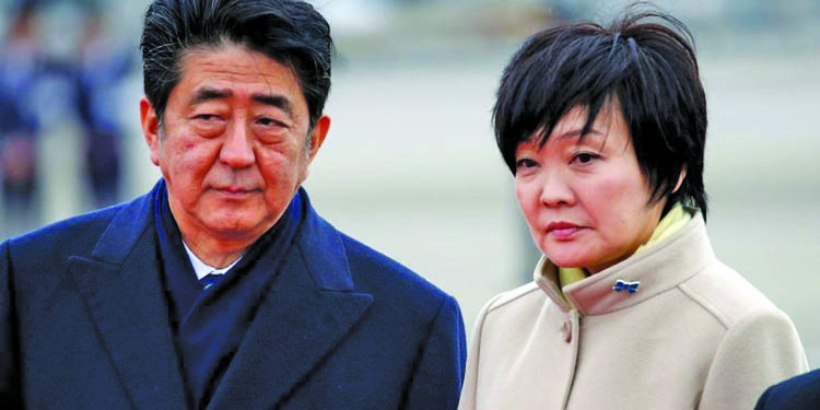 Abe battles scandal on two fronts