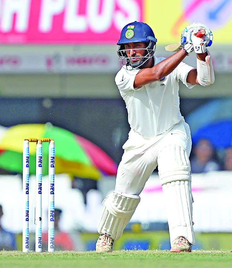 Pujara ton steers India against Australia
