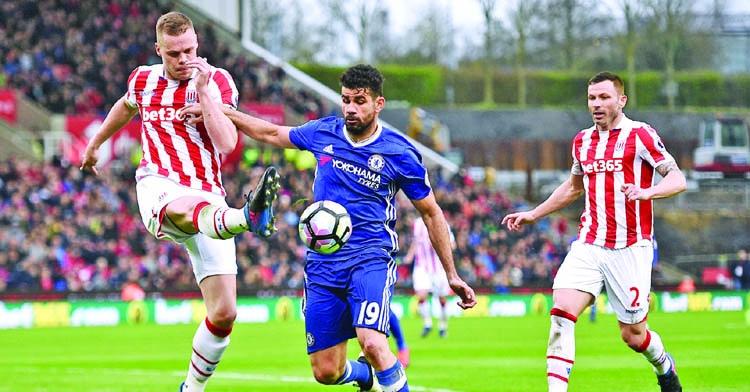 Chelsea down Stoke City, Dawson darkens Arsenal gloom