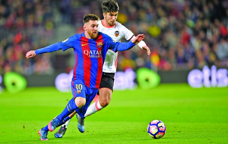 Messi double edges six goal thriller Barca's way
