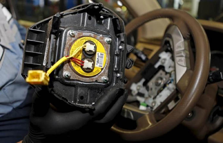 4 car makers settle claims over Takata