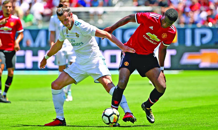 Manchester United down Real Madrid on penalties
