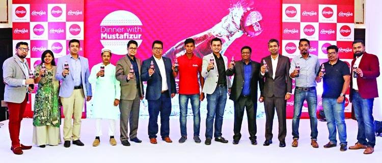 Mustafizur dine with Coca-Cola's Radio Contests winners