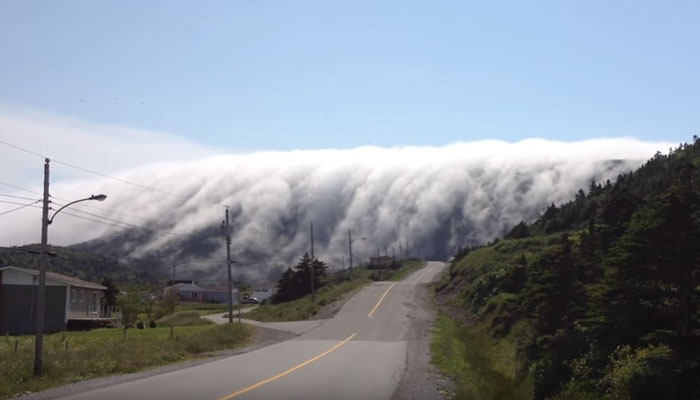 [WATCH] Low-level tube-shaped cloud rolls over Canada highway