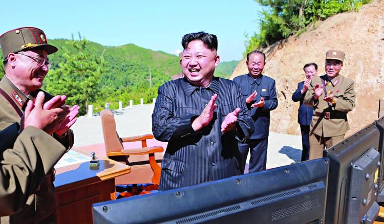 Markets slide, dollar slumps as North Korea fears spike
