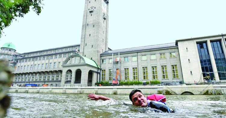 Sick of traffic, German swims to work