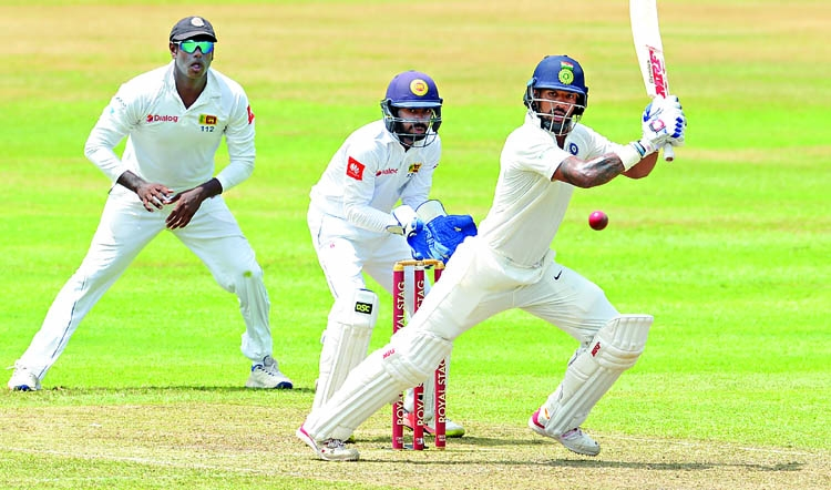 Sri Lanka spinners hit back after Dhawan ton