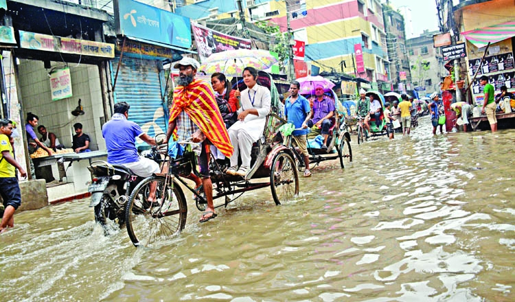 Rain throws city life out of gear