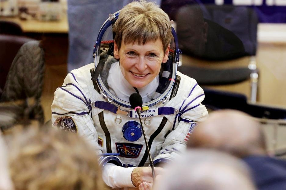 Record-breaking US astronaut back on Earth