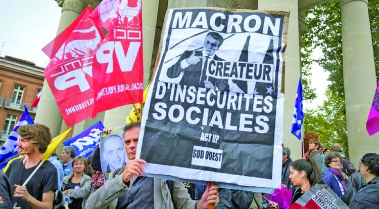 Labor protests hit France in key challenge for Macron