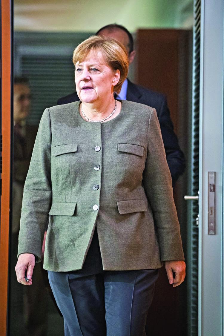 Merkel threatens to kick Budapest out of EU