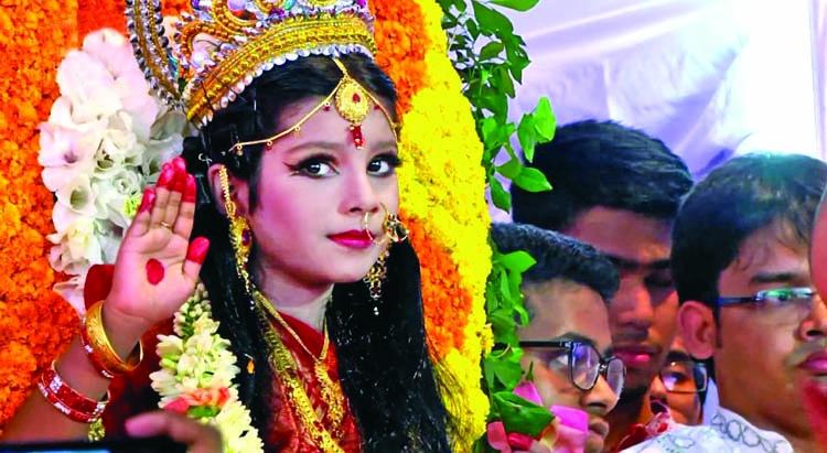 Worshipping Kumari: Heavenly scene of Durga Puja