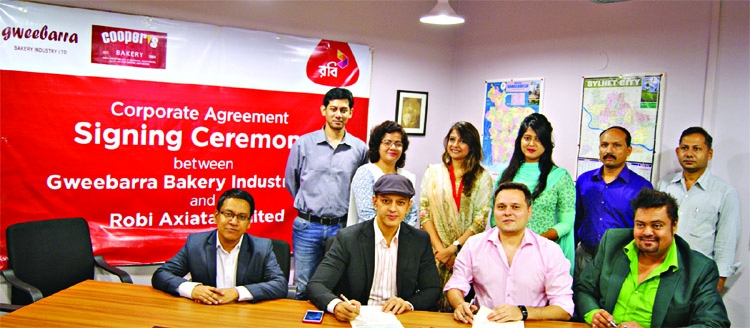 Robi and Cooper's sign corporate agreement