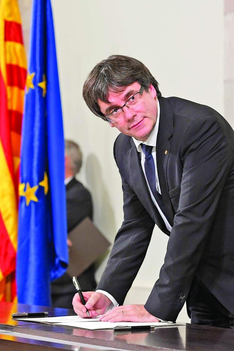 Catalan leader suspends independence
