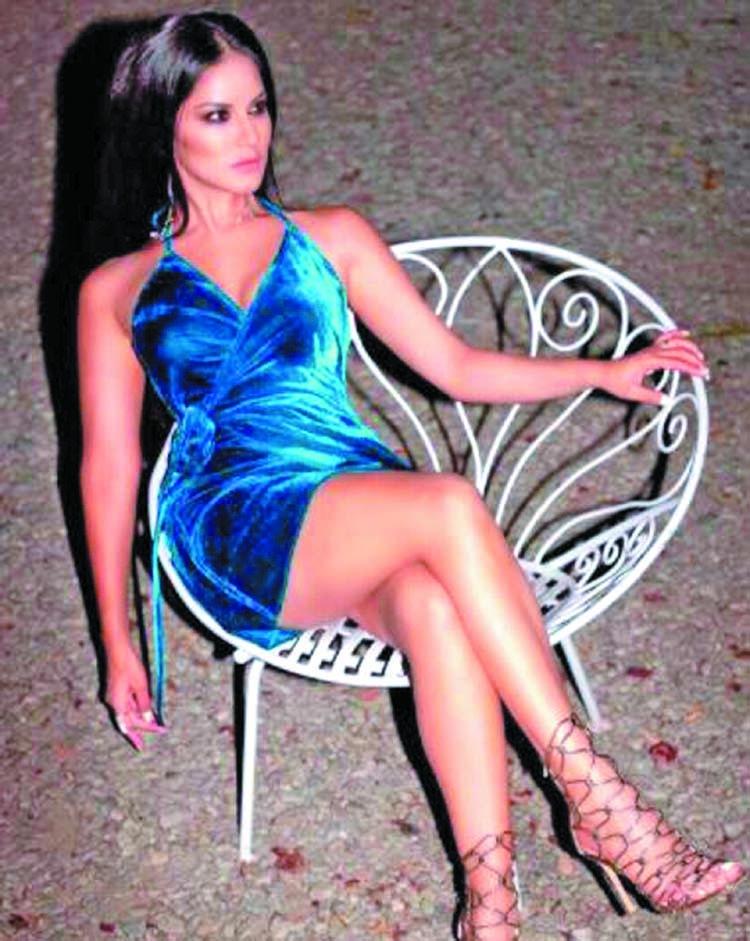 Sunny Leone looks blazing hot in a blue mini dress