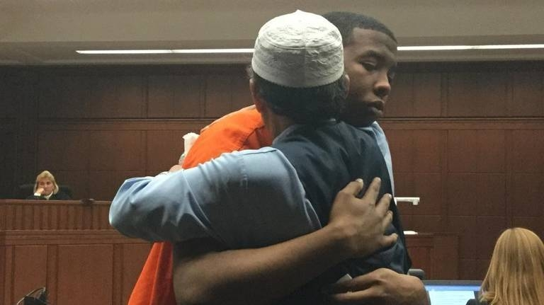 Father of a murdered pizza delivery man hugs son's killer, brings judge to tears
