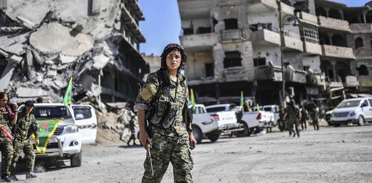 A wary return to Raqqa