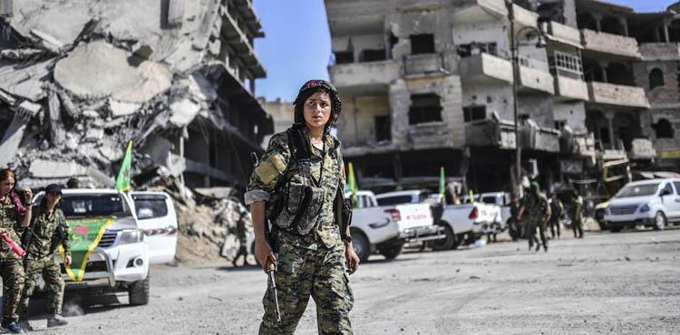 A wary return to Raqqa