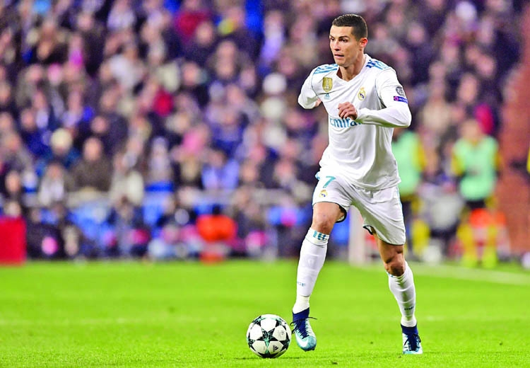 Ronaldo claims new record, Liverpool reach into last 16