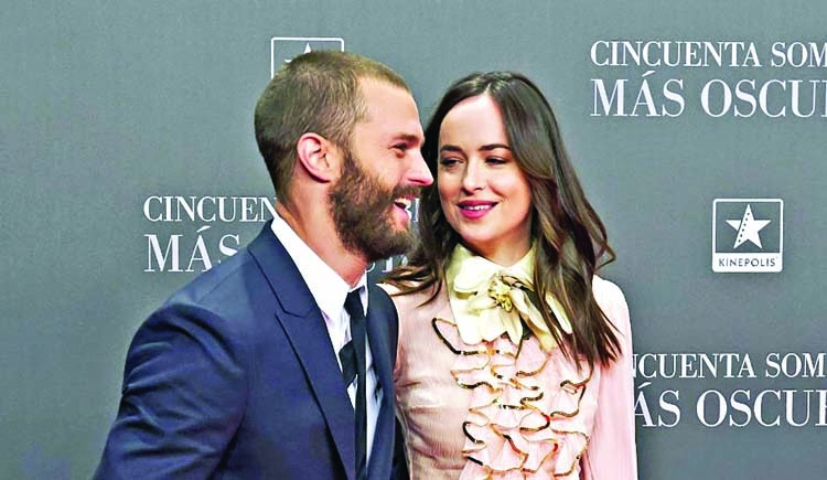 Dakota Johnson, Chris Martin take a romantic walk