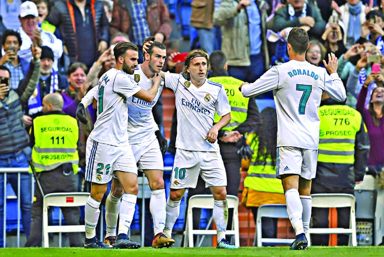 Real defy crisis talk as Barca extend lead