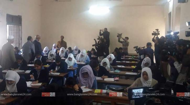 Nahid enters exam hall with camera again