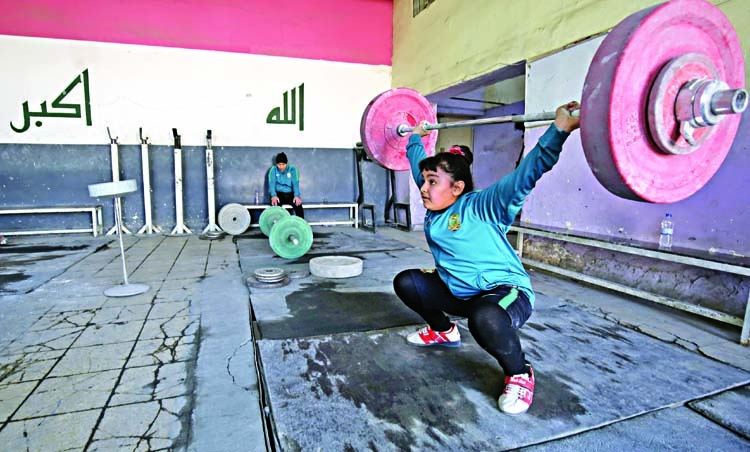 Iraq's girl weightlifters boost family finances