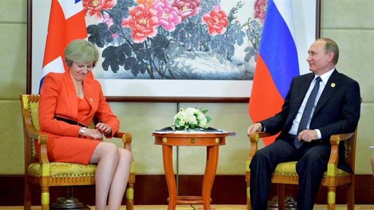 May faces down Putin, but he has the upper hand