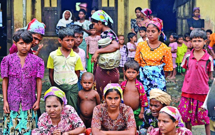 Rohingya families reinforce shelters ahead of monsoon